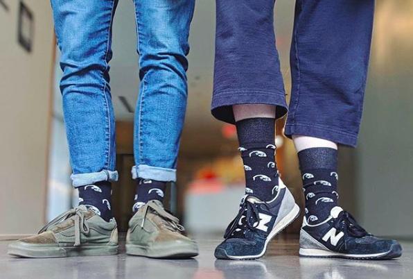 guys wearing custom socks a thinking age company logo